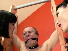 Two brunettes torture their submissive