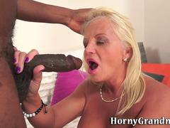 This blonde granny is eager to taste that black monster cock for the first time