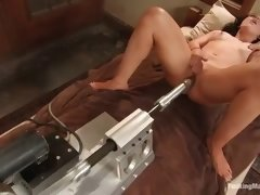 stunning brunette is fucked by a machine
