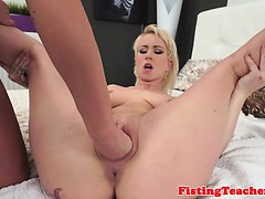 Tattooed girl fisted on the bed