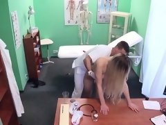 Blonde sucks big cock to doctor