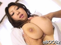 Asian model with big milk shakes goes wild on 2 big knobs