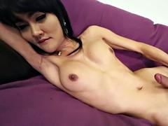 Solo asian shemale in stockings masturbates