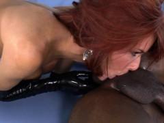 Redhead femdom deepthroats big black cock