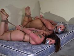 Two nude girls hogtied, toetied on mattress