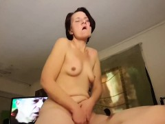 Mature wife riding her skinny husband on a couch