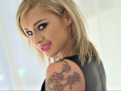 artfully inked girl kleio valentien posing in a leather bra and tight shorts