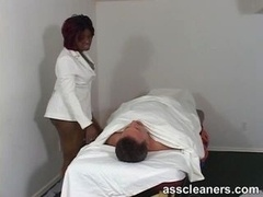 Chubby ebony doctor smothers a complaining patient by sitting on his face so he can talk no more great stuff
