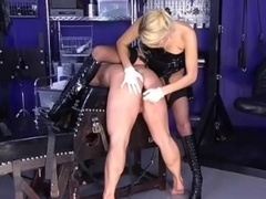 Strapon Domme in Boots and besides Stockings