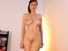Hot babe with big boobs stripteasing and seducing on webcam