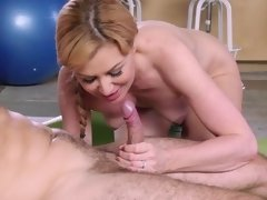 A blonde with short hair and a sexy body is getting stretched