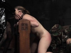 Bondage submissive sucking strapon in femdom