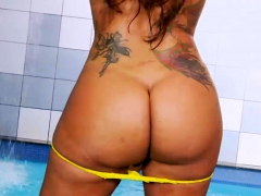 Lusty shemale with big boobs jerks off by the poolside