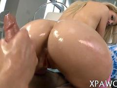 Blonde oiled up for a slick pussy fucking in doggy style
