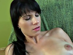 random brunette in solo action on the couch