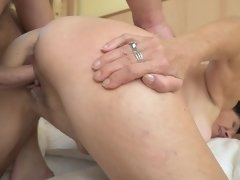 Mature brunette and young inamorato enjoy sex in bed