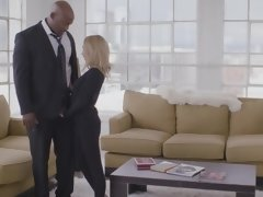 A blonde is sucking and riding a big black pecker on the sofa