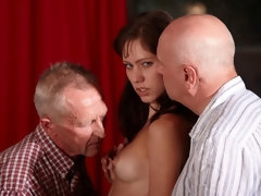 Cute slender brunette Aspen penetrated by two hard old dicks